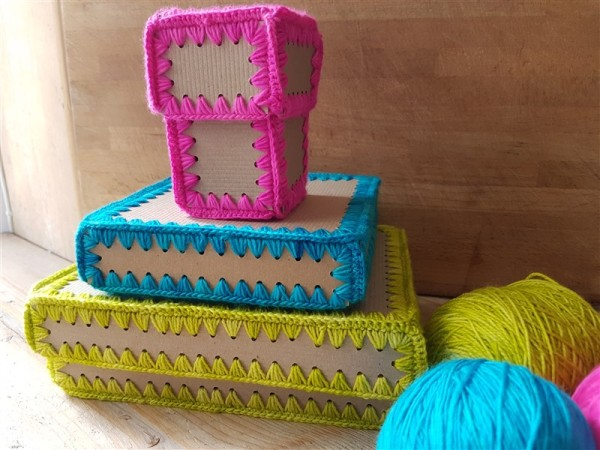 olann-and-spring-awakenigs-crafty-make-crochet-gift-boxes-piled-up-with-yarn-landscape