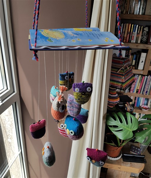 leftfootdaisy-wise-old-knitted-owls-mobile-in-the-window